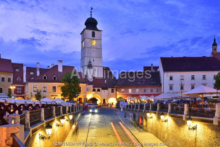 Old Town Hall Tower (Council Tower) and Piata Mica at dusk. Sibiu, Transylvania. Romania