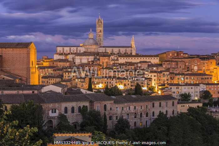 Italy, Tuscany, Siena, listed as World Heritage by UNESCO, view of the Our Lady of the Assumption cathedral, the Duomo and the Basilica di San Domenico on left