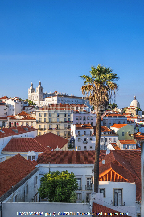 awl-images.com - Portugal / Portugal, Lisbon, view over the rooftops of the Alfama district from the terrace of Largo das Portas do Sol, Sao Vicente de Fora monastery and Pantheon cupola
