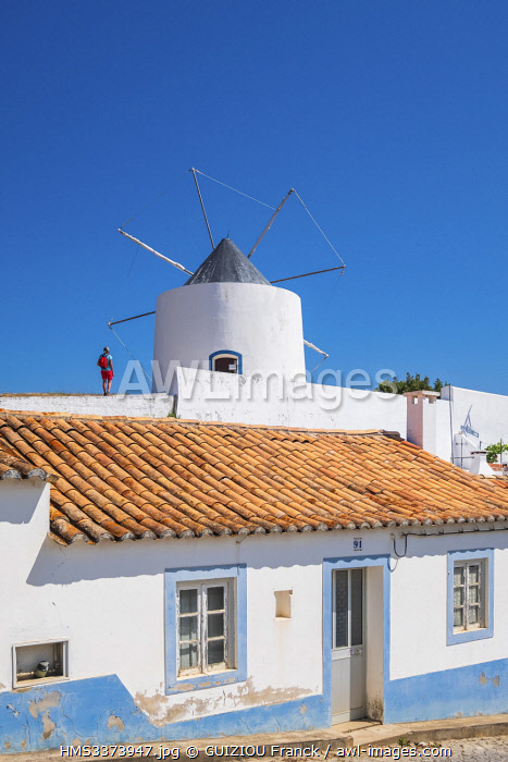 awl-images.com - Portugal / Portugal, Algarve region, Southwest Alentejano and Costa Vicentina Natural Park, Odeceixe on the hiking trail Rota Vicentina, the wind mill overlooks the village