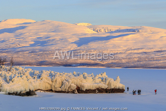 awl-images.com - Sweden / Sweden, Lapland, region listed as World Heritage by UNESCO, Norrbotten County, First light after the Arctic winter on ice formations on Lake Tornetrask in Abisko National Park