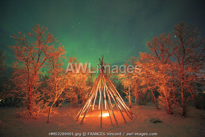 awl-images.com - Sweden / Sweden, Lapland, region listed as World Heritage by UNESCO, Norrbotten County, Aurora Borealis above a traditional Sami tent in Abisko National Park