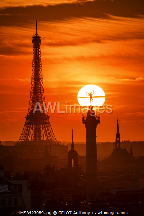 France, Paris, the sun setting behind the genius of the Bastille (column of July) and Eiffel Tower (� SETE-illuminations Pierre Bideau)