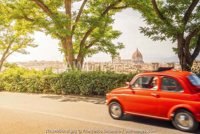 Original old red Fiat Cinquecento (500) with Florence Cathedral in background, Tuscany, Italy.