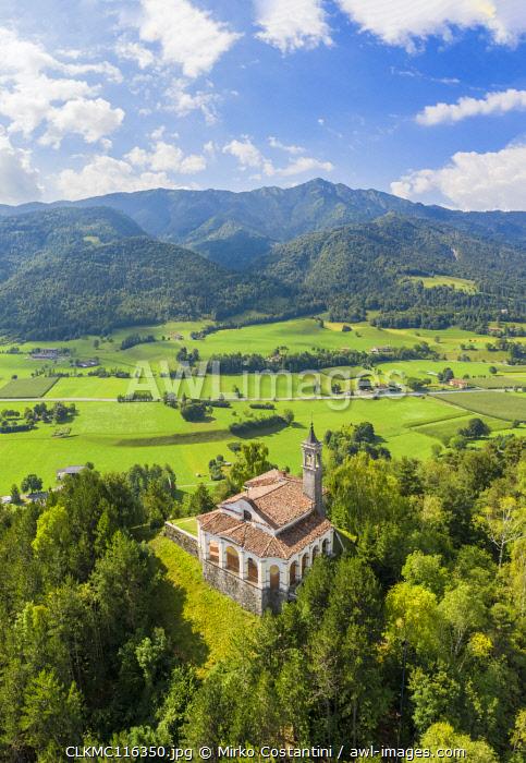 Aerial view of the fields surrounding the small church of Chiesa della Santissima Trinità in Clusone city. Val Seriana, Bergamo district, Lombardy, Italy.