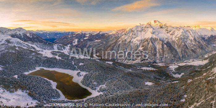 Sunrise aerial view of Lake Palu after an early snowfall Malenco Valley Valtellina Lombardy Italy