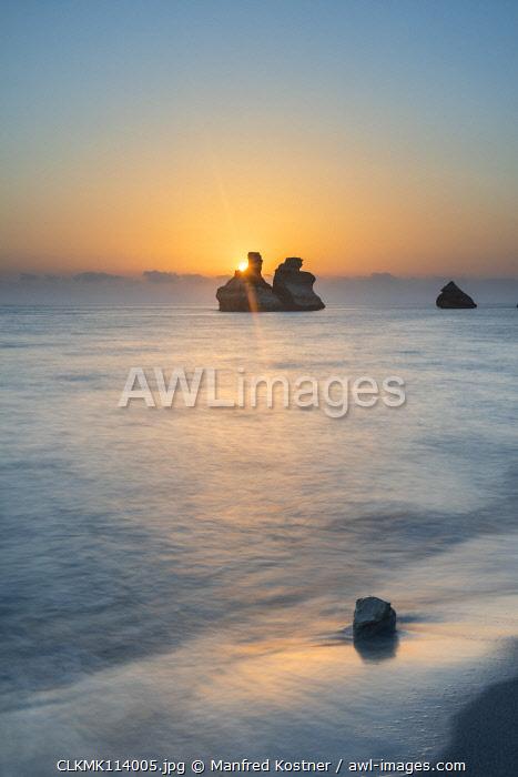 Torre dell'Orso, Melendugno, province of Lecce, Salento, Apulia, Italy, Europe. The Due Sorelle (Two Sisters) at sunrise