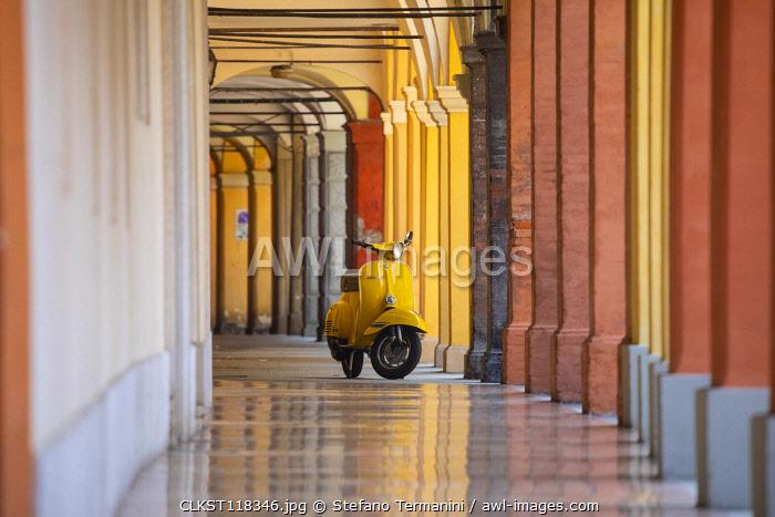Yellow Vespa in Modena historic city. Modena old town, Emilia Romagna, Italy.