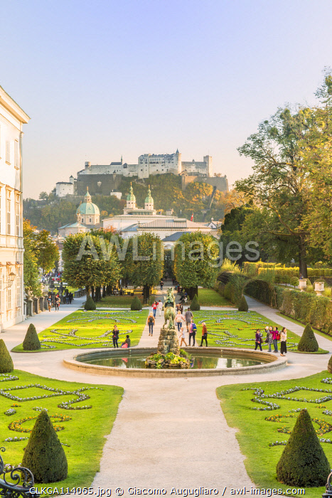 Tourists visiting Mirabell garden and the Old town in the background, Salzburg, Salzburger Land, Austria, Europe