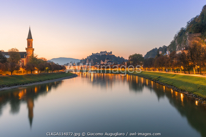 Historical old town of Salzburg reflected in Salzach river at dusk with Hohensalzburg Fortress in the background, Salzburg, Salzburger Land, Austria, Europe