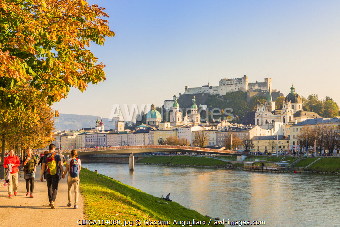 Tourists walking on the cycle path along Salzach river with the old town in the background, Salzburg, Salzburger Land, Austria, Europe