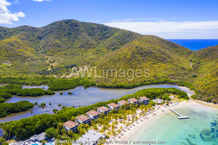Aerial view of luxury resort on palm-fringed beach from above, Carlisle Bay, Antigua, Antigua and Barbuda, Caribbean, West Indies