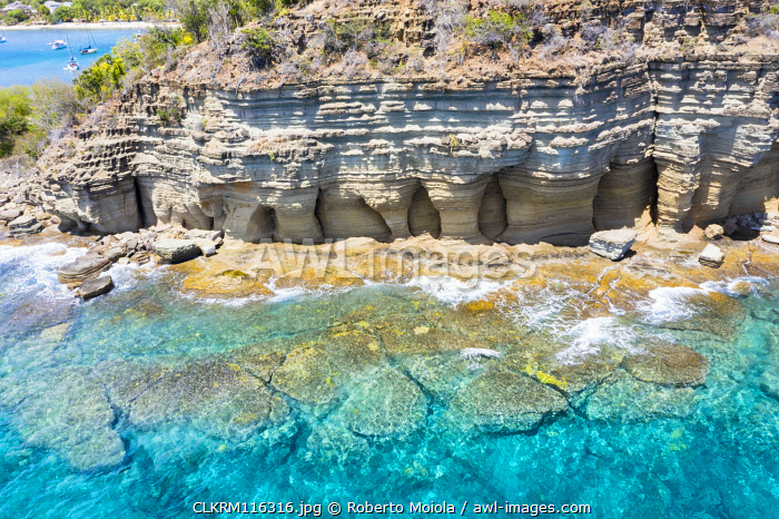 White limestone cliffs Pillar of Hercules washed by Caribbean Sea, aerial view, English Harbour, Antigua, West Indies