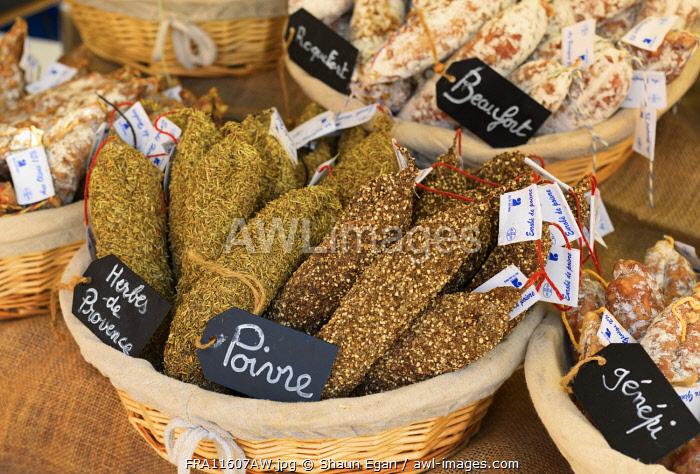 France, Provence, Alpes Cote d'Azur, Castellane, cured meat at market stall