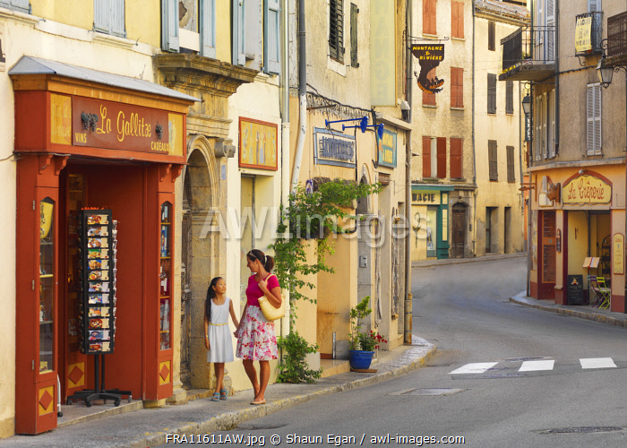 France, Provence,  Alpes Cote d'Azur, Castellane, woman and girl shopping (MR)