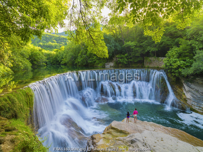 France, Lozere, Longuedoc-Roussillon, Gorges du Tarn, Woman and girl at Waterfall (MR)