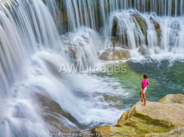 France, Lozere, Longuedoc-Roussillon, Gorges du Tarn, Woman at Waterfall (MR)