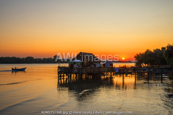 Pier with boats and fishermen at the Saint George branch of the Danube, Saint George, Danube Delta, Dobrudscha, Romania