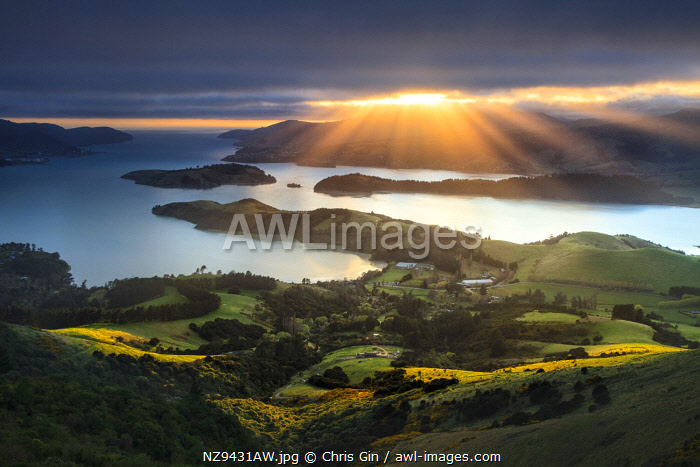 Sun rays breaking through clouds, from the Port Hills, Christchurch, New Zealand