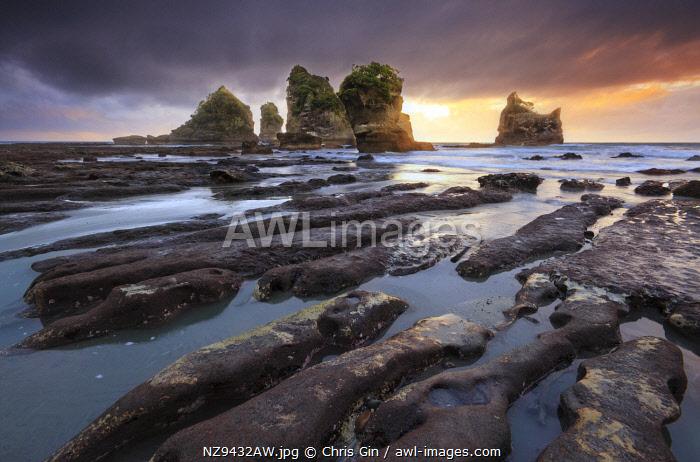 Sunset at Motukieie beach, West Coast, New Zealand
