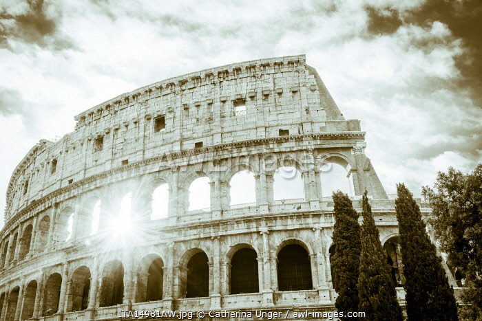 Europe, Italy, Rome. The Colosseum with morning sun, black and white.