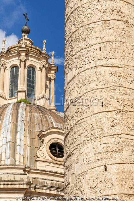Europe, Italy, Rome. Close up of the Trajan's column with the cupola of the church Santissimo Nome di Maria