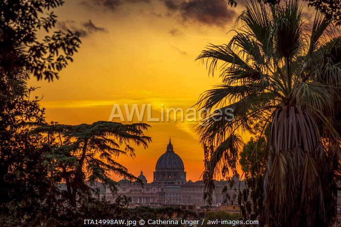 Europe, Italy, Rome. View toward the dome of Saint Peter's at sunset from the Pincio Terrace and Villa Borghese.