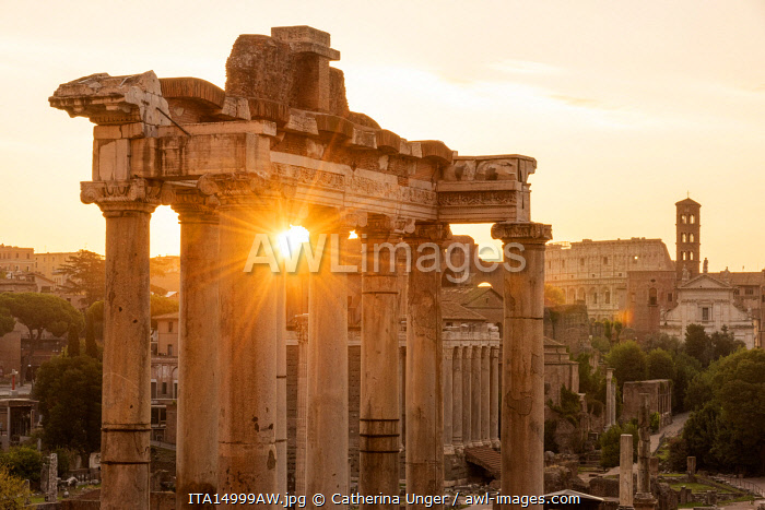 Europe, Italy, Rome. The Forum Romanum with the temple of Saturn in the rising sun.