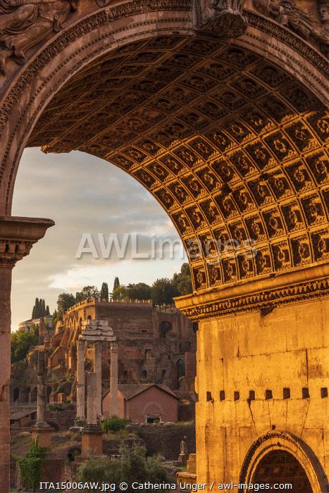 Europe, Italy, Rome. The  arch of Septimus Severus in the Forum Romanum at sunrise.