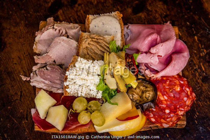 Europe, Italy, Rome. A platter with typical italian starters, cheese and cold meats
