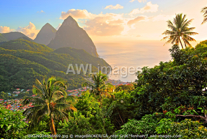 Tropical landscape with view of the village and the two Pitons, Gros Piton 770m and Petit Piton 743m, evening sun, Soufriere, St. Lucia, Lesser Antilles, West Indian Islands, Caribbean Sea