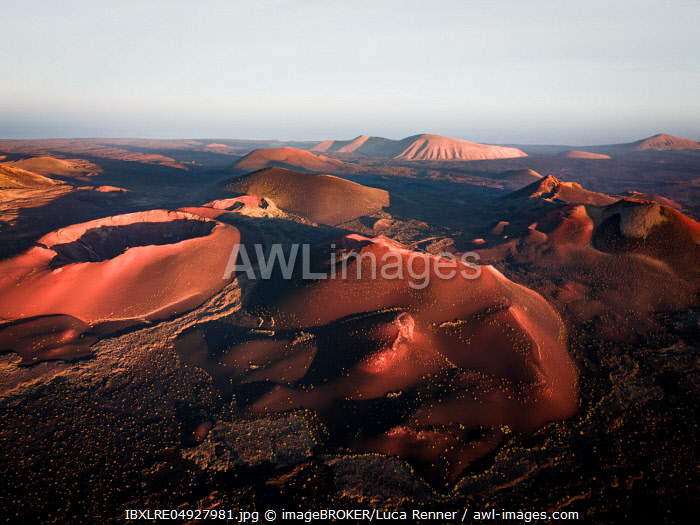 Sunrise volcanic crater, crater landscape, Timanfaya National Park, drone shot, Lanzarote, Spain, Europe