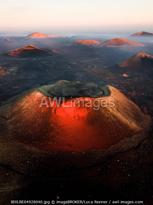 Volcano Montana Colorada with sunrise volcano crater, fire mountains, crater landscape, Timanfaya National Park, drone shot, Lanzarote, Spain, Europe