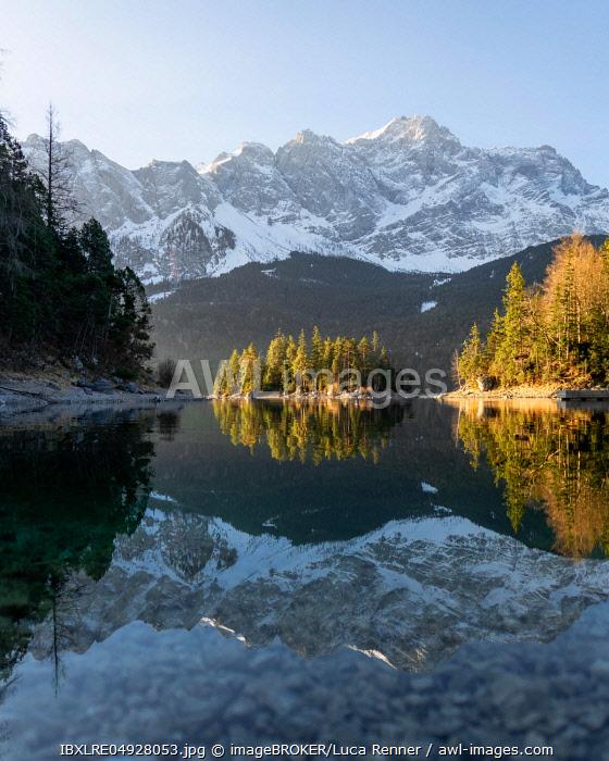 Eibsee lake with Zugspitze, water reflection, trees, Garmisch-Partenkirchen, Germany, Europe