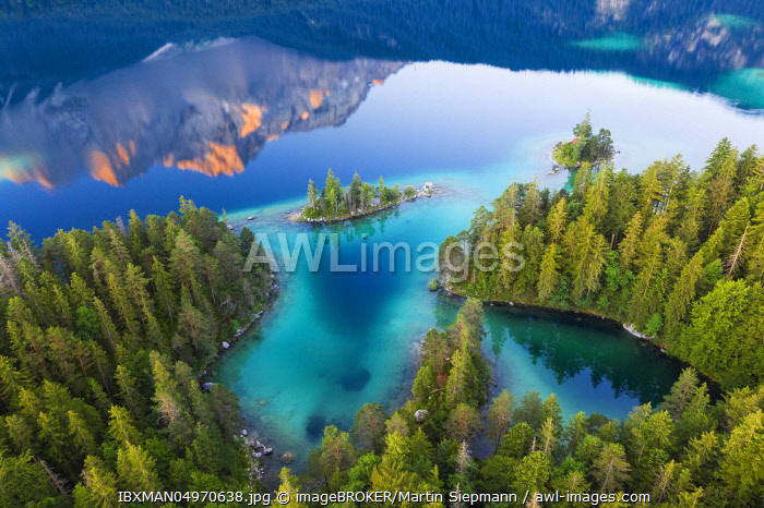 Eibsee lake with Braxen island and water reflection of the Zugspitze in the morning light, near Grainau, Werdenfelser Land, aerial view, Upper Bavaria, Bavaria, Germany, Europe