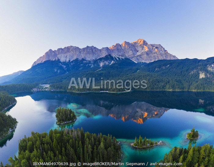 Eibsee lake with Wetterstein range and Zugspitze in the morning light, near Grainau, Werdenfelser Land, aerial view, Upper Bavaria, Bavaria, Germany, Europe