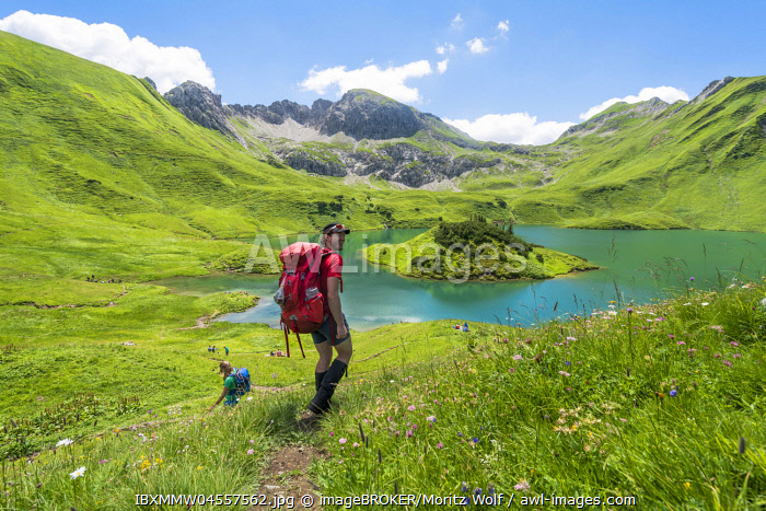 Hiker on hiking trail, Schrecksee and Allgaeu Alps, Bad Hindelang, Allg�u, Bavaria, Germany, Europe