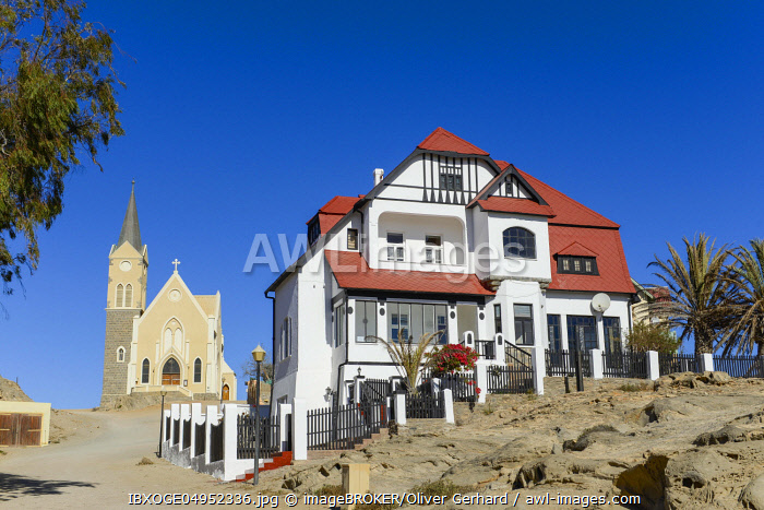 Half-timbered house from German colonial times and rock church in the old town of Luderitz, Namibia, Africa