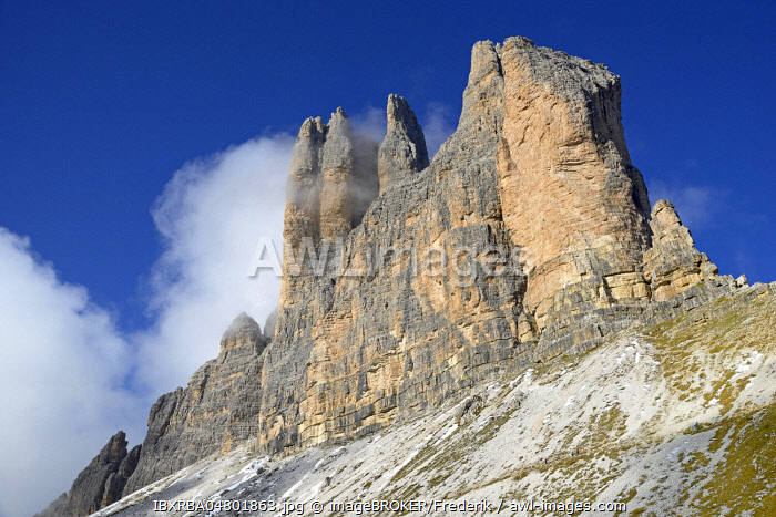 Three Peaks of Lavaredo south faces with deep clouds, blue sky, Sexten Dolomites, Province South Tyrol, Alto-Adige, Italy, Europe