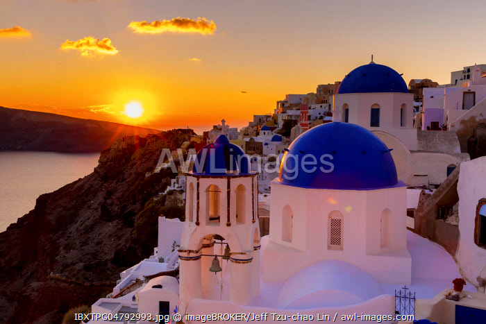 Sunset over the Orthodox Church in Oia, Santorini, Cyclades, Greece, Europe