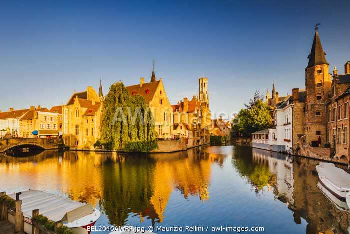 awl-images.com - Belgium / View of Bruges old town reflecting in the water canal at sunrise, Belgium