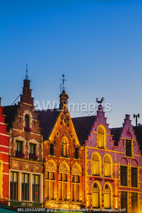 awl-images.com - Belgium / Detail of the colored houses facades in Markt Square in Bruges by night, Belgium