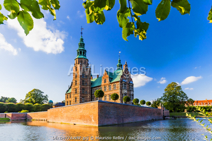 Rosenborg castle reflecting in the water at sunset in Copenhagen, Denmark