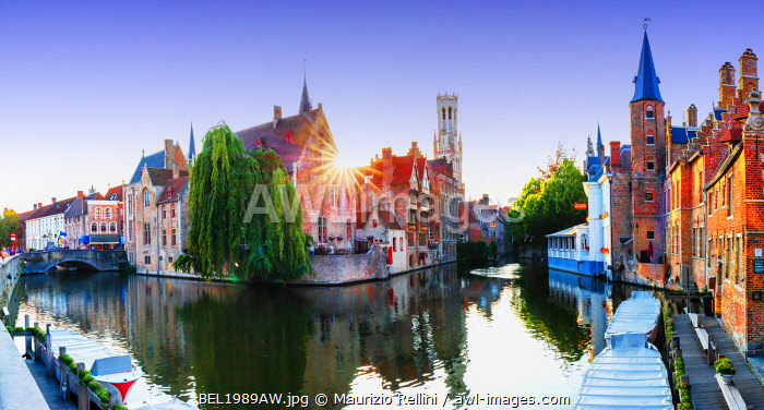 Panoramic view of Bruges old town reflecting in the water canal at sunset, Belgium