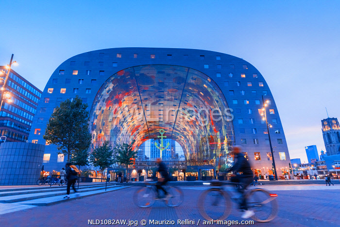 awl-images.com - Netherlands / People riding bikes in front of the Market Hall in Rotterdam on a summer evening, Holland/Netherlands