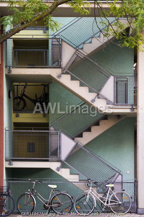 awl-images.com - Germany / Bicycles parked in front of a multiple storey block house in central Nuremberg, Middle Franconia, Bavaria, Germany