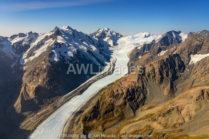 awl-images.com - New Zealand / Aerial view of Tasman Glacier and mountain ranges in Aoraki / Mount Cook National Park, Mackenzie District, Canterbury, South Island, New Zealand