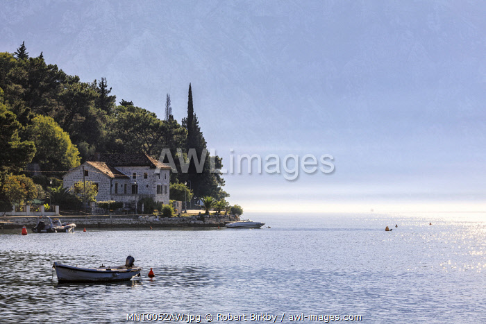 awl-images.com - Montenegro / Montenegro, Bay of Kotor, Perast. Morning mist at the harbour.