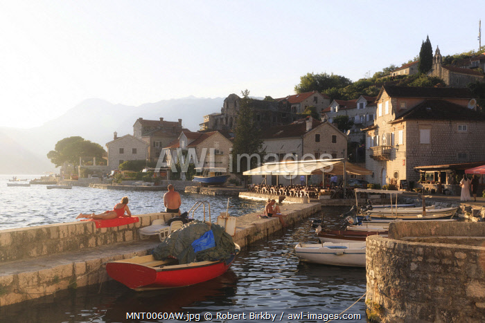awl-images.com - Montenegro / Montenegro, Bay of Kotor, Perast. The harbour at sunset.