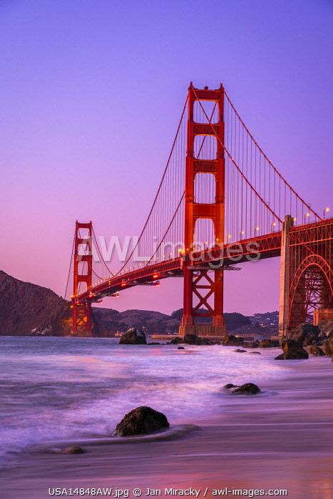 Famous Golden Gate Bridge over bay against purple sky during sunset, San Francisco, San Francisco Peninsula, Northern California, California, USA